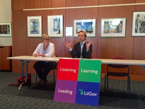 Michigan Lt. Gov. Brian Calley, right, and Michelle Fecteau of the Michigan State Board of Education, in Traverse City Aug. 5, were sympathetic to the case for year-round school.